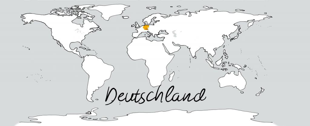 Eine weiße Weltkarte mit einem goldenen Fleck in der Position von Deutschland.